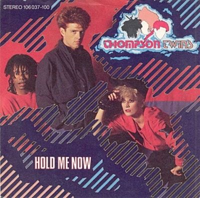 "Hold Me Now - Thompson Twins (Winyl, 7"", 45 RPM, Singiel, ℗ © 1983) - przód główny"